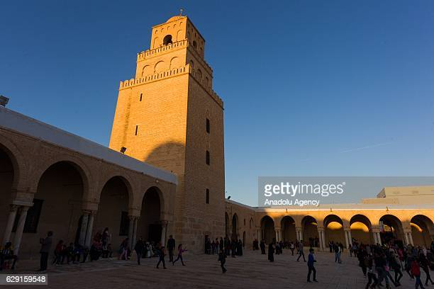 Muslims on their way to the Great Mosque of Kairouan, also known as the Mosque of Uqba, to attend the celebrations for Mawlid al-Nabi, the birth...
