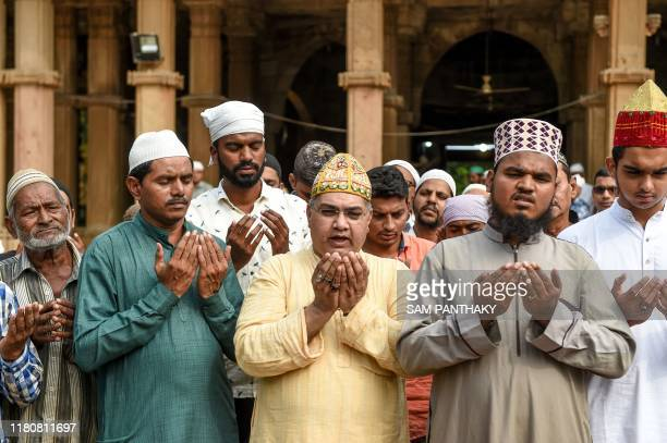 Muslims participate in a special prayer asking to maintain peace and harmony across India ahead of the court verdict of disputed religious site of...