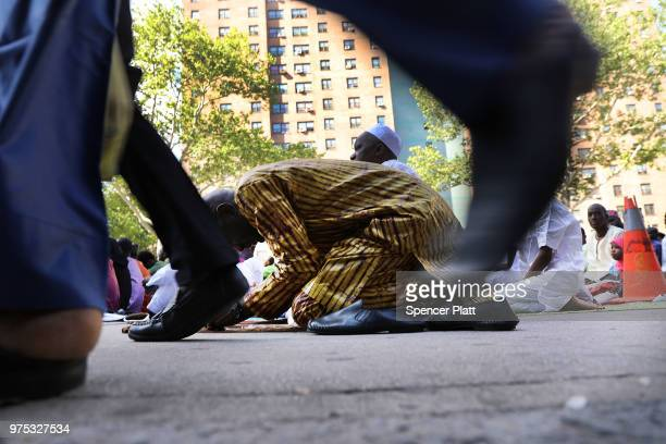 Muslims participate in an outdoor prayer event at Masjid AqsaSalam mosque Manhattan's oldest West African mosque to mark the end of Ramadan on June...