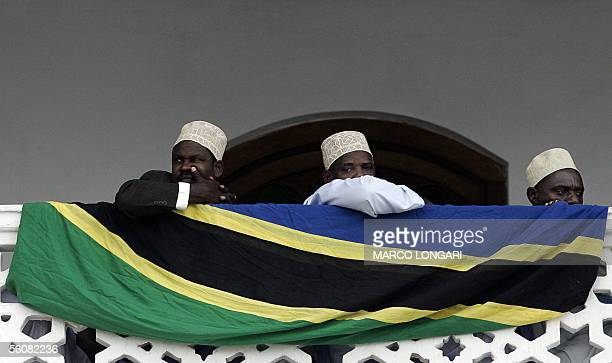 Muslims peer from a balcony of the Palace Museum in Stone Town Zanzibar 04 November 2005 during the celebrations for the Eid El Fitr the festivity...