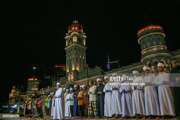 Muslims perform a special prayer called 'taraweeh' in front of Sultan Abdul Samad building at Independent Square during the holy month of Ramadan on...