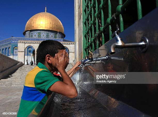 Muslims perform ablutions as they prepare to attend prayer in the compound of AlAqsa Mosque on July 11 during the Muslim holy month of Ramadan in...