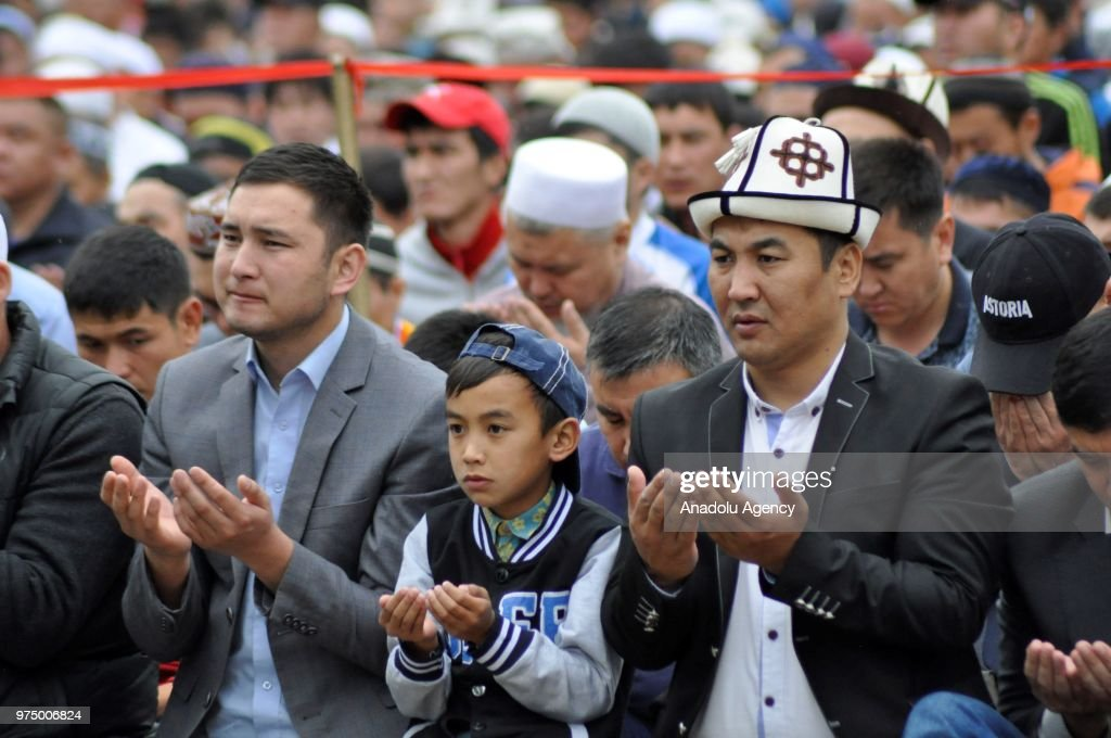 Muslims perform Eid al-Fitr prayer at a square in front of the Prime Ministry building in Bishkek, Kyrgyzstan on June 15, 2018. Eid al-Fitr is a religious holiday celebrated by Muslims around the world that marks the end of Ramadan, Islamic holy month of fasting.