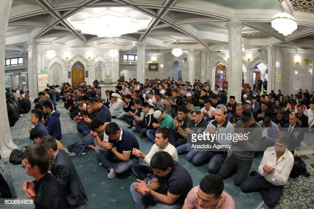Muslims perform Eid alFitr prayer at Kul Sharif Mosque in Kazan Russia on June 25 2017 Eid alFitr is a religious holiday celebrated by Muslims around...