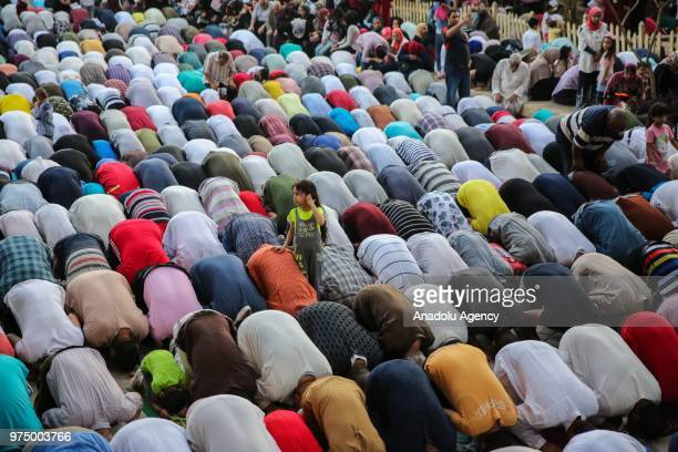Muslims perform Eid alFitr prayer at MosqueMadrassa of Sultan Hassan in Cairo Egypt on June 15 2018 Eid alFitr is a religious holiday celebrated by...