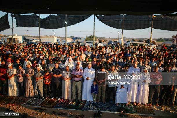 Muslims perform Eid alFitr prayer at return camp located at east of Khan Yunis Gaza on June 15 2018 Eid alFitr is a religious holiday celebrated by...