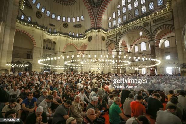 Muslims perform Eid alFitr prayer at Suleymaniye Mosque in Istanbul Turkey on June 15 2018 Eid alFitr is a religious holiday celebrated by Muslims...