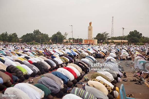 Muslims perform Eid al-Fitr prayer at United Nations Square in Ouagadougou, Burkina Faso on July 06 ,2016. Muslims around the world are celebrating...