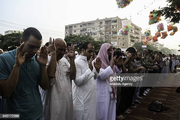 Muslims perform Eid alFitr prayer during the Eid alFitr holiday at Abu Bakr alSiddiq Mosque in Cairo Egypt on July 06 2016 Eid alFitr is a religious...