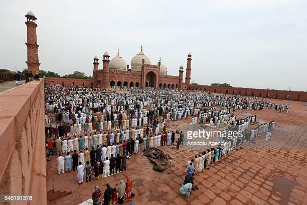 Muslims perform Eid al-Fitr prayer during the Eid al-Fitr holiday at Badshahi Mosque in Lahore, Pakistan on July 06, 2016. Muslims around the world...