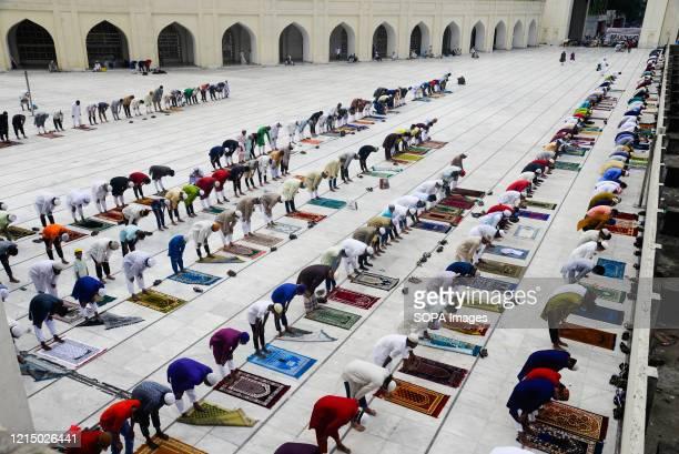 Muslims perform Eid al-Fitr prayers with no social distancing at the Baitul Mukarram National Mosque amid coronavirus crisis. Eid Al-Fitr marks the...
