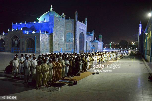 Muslims perform evening prayer called 'tarawih' on the eve of the first day of the Ramadan at the Blue Mosque also known as The Shrine of Hazrat Ali...