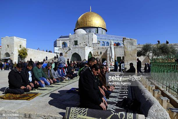 Muslims perform Friday prayers on the courtyard of the AlAqsa Mosque the third holiest site in Islam in Jerusalem on December 25 2015