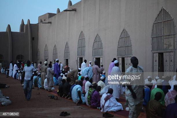 Muslims perform prayer at the mosque in Djenne Mali on October 6 2014 The Great Mosque of Djenne is the largest mud brick building in the world and...