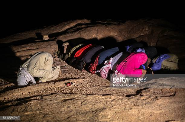 Muslims perform prayer on the Laylat alQadr the night when the first verses of the Quran were revealed at Mount Moses in Sinai Peninsula Egypt on...