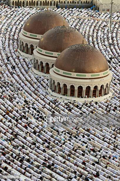 Muslims perform the early morning Eid AlFitr prayer at the Grand Mosque in the Saudi holy city of Mecca on September 10 2010 as Muslilms around the...