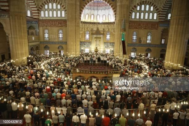 Muslims perform the Eid Al Adha prayer at historical Selimiye Mosque in Edirne Turkey on August 21 2018 Muslims worldwide celebrate Eid AlAdha to...
