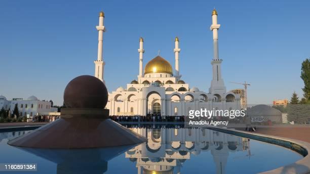 Muslims perform the Eid Al Adha prayer at the Central Nur Astana Mosque in Nur Sultan Kazakhstan on August 11 2019 Muslims worldwide celebrate Eid...