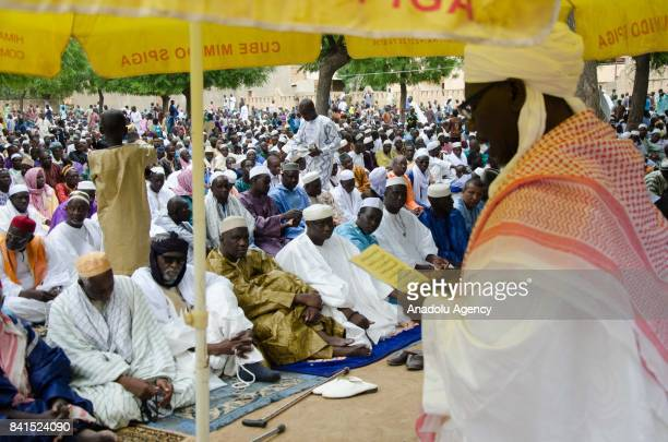 Muslims perform the Eid AlAdha prayer at Grand Mosque in Djenne Mali on September 01 2017 Muslims worldwide celebrate Eid AlAdha to commemorate the...