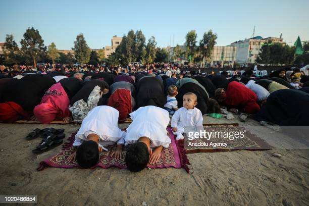 Muslims perform the Eid AlAdha prayer at Saraya Square in Gaza City Gaza on August 21 2018