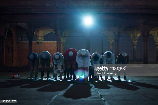Muslims perform the first Tarawih prayer on the beginning of the Holy month of Ramadan at Jama Masjid in New Delhi India on May 17 2018 The confusion...