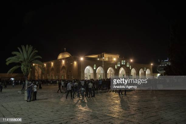 Muslims perform the first 'Tarawih' prayer on the beginning of the Islamic Holy month of Ramadan at the yard of the AlAqsa Mosque in Jerusalem on May...