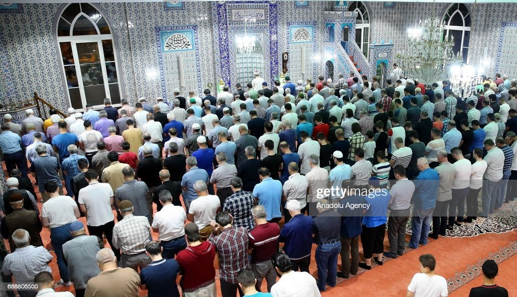 Muslims perform the first 'Tarawih' prayer on the eve of the Islamic holy month of Ramadan at Fatih Mosque in Beringen, Belgium on May 26, 2017.