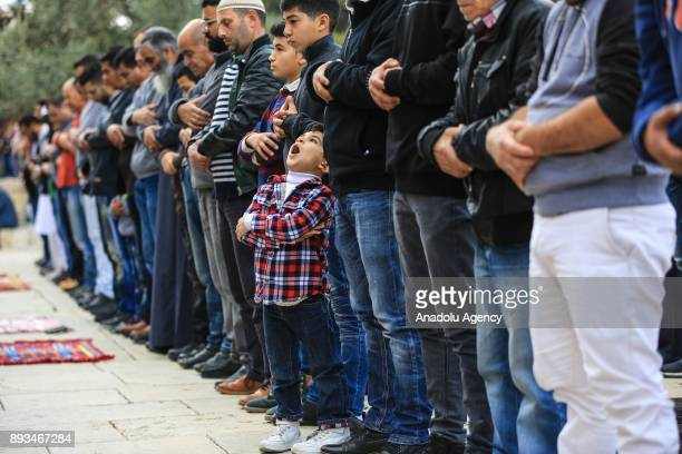 Muslims perform the Friday Prayer alAqsa Mosque compound in Jerusalem on December 15 2017