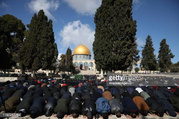 Muslims perform the Friday Prayer at AlAqsa Mosque Compound in Jerusalem on January 31 2020