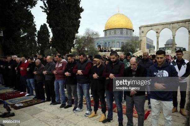 Muslims perform the Friday Prayer at AlAqsa Mosque Compound in Jerusalem on December 29 2017