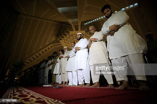 Muslims perform the 'tarawih' prayer marking the first eve of Islamic holy month of Ramadan at Faisal Mosque in Islamabad Pakistan on June 18 2015