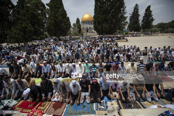 Muslims perform the third Friday Prayer of holy fasting month of Ramadan in front of the Kubbet'usSahra at AlAqsa Mosque compound in Jerusalem on May...