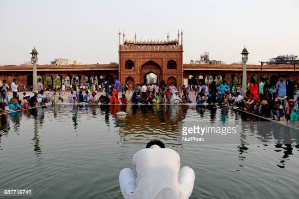Muslims performing ablution at Jama Masjid Delhi India on 13 May 2017