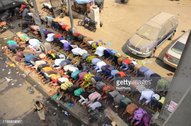Muslims pray a jumat service at Ojota under bridge in Lagos, January 24, 2020.