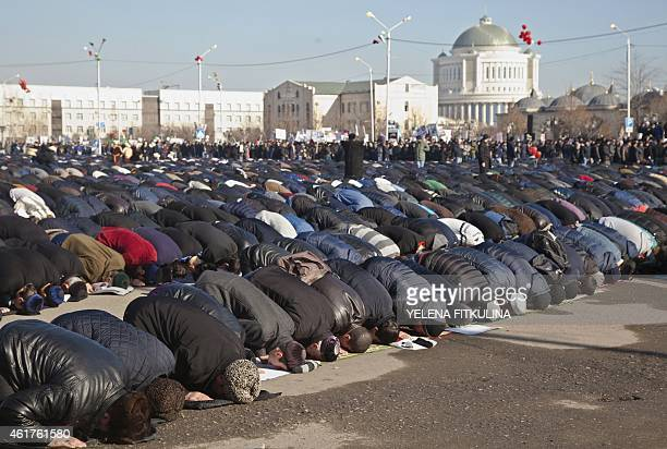 Muslims pray as they take part in a rally against the publication of cartoons of the Prophet Mohammed by French weekly Charlie Hebdo in the Chechen...
