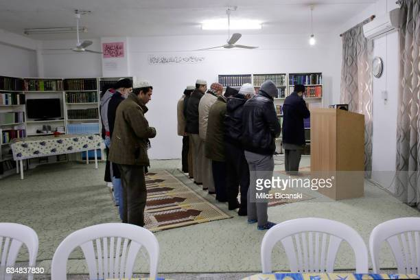 Muslims pray at a Ahmadiyya Muslim Community makeshift mosque that was converted from apartment on February 5 2017 in Athens Greece Since the end of...