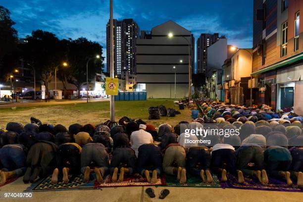 Muslims pray at dusk in the Little India area of Singapore on Wednesday June 13 2018 Tourism as well as the consumer sector will likely see a lift...