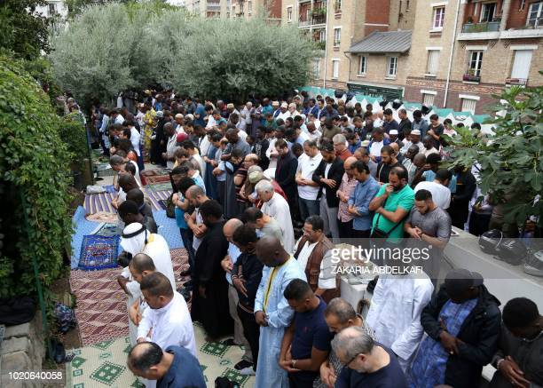 Muslims pray at The Grande Mosque in Paris on August 21 as they celebrate the first day of the Islamic Festical of Eid alAdha Muslims across the...