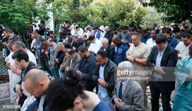 Muslims pray at the Grande Mosquee de Paris in Paris at the start of the Eid alFitr holiday which marks the end of Ramadan on June 15 2018