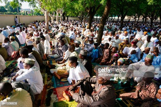 Muslims pray at the mosque during the Eid alAdha celebrations in the district of Hotoro in Kano northern Nigerian on September 1 2017 Muslims across...