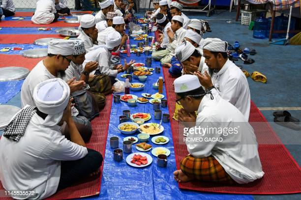 Muslims pray before breaking their fast during the Islamic holy month of Ramadan at the compound of Haroon mosque in Bangkok on May 22 2019