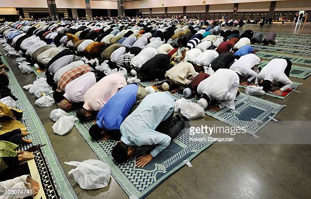 Muslims pray during a special Eid ulFitr morning prayer at the Los Angeles Convention Center on August 30 2011 in Los Angeles California The threeday...