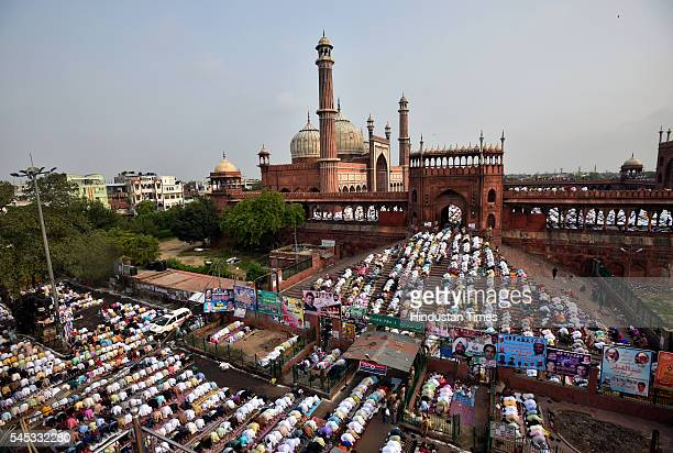 Muslims pray during morning prayer for Eid alFitr marking the end of the holy month of Ramadan at Jama Masjid on July 7 2016 in New Delhi India The...