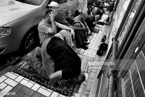 Muslims pray during the Friday Worship Service in front of the Assalam Mosque in the centre of Malaga, Andalusia, Spain, 28 April 2007. Strong...