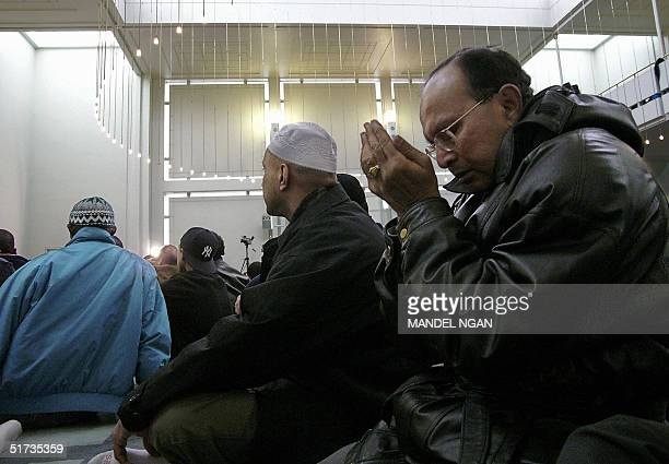 Muslims pray during the last Friday prayers of the holy month of Ramadan 12 November 2004 at a mosque in New York The congregation also offered...