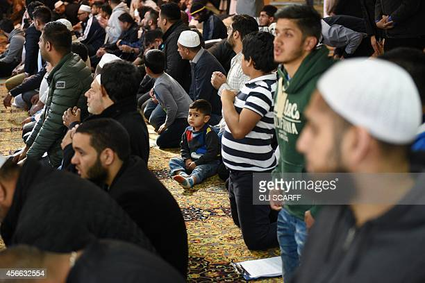 Muslims pray for murdered aid worker Alan Henning in Manchester Central Mosque in Manchester north west England on October 4 2014 Britain reacted...