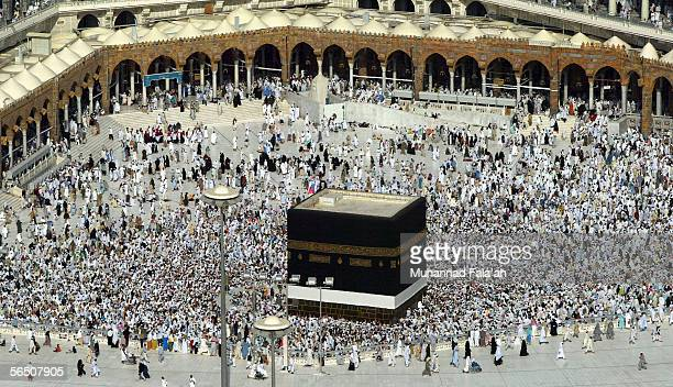 Muslims pray in front of the Grand Mosque and holy Kabba, the most holy place for Muslims around the world on December 31, 2005 in the city of Mecca,...