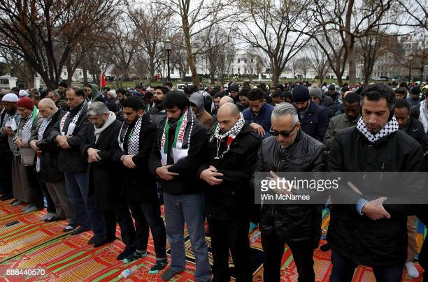 Muslims pray in Lafayette Park across from the White House December 8 2017 in Washington DC The American Muslims for Palestine group gathered to...