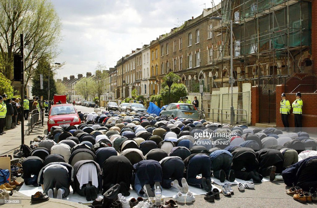 Muslims pray on a residential street out : News Photo