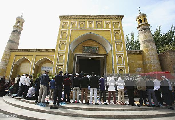 Muslims pray outside a mosque on September 22, 2006 in Kashi of Xinjiang Uygur Autonomous Region, northwest China. Kashi is an oasis city which has...